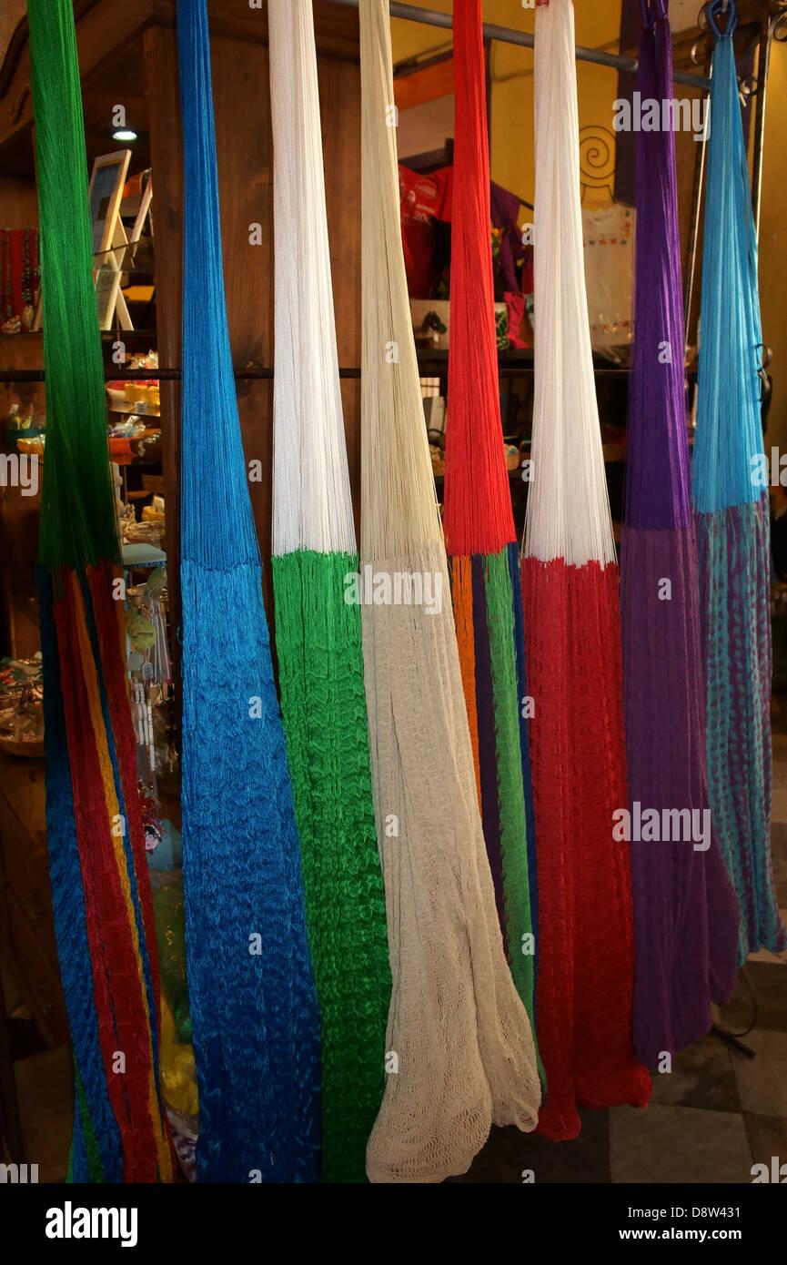 Colorful hammocks for sale in the Casa de Artesanias, Merida, Yucatan, Mexico - Stock Image