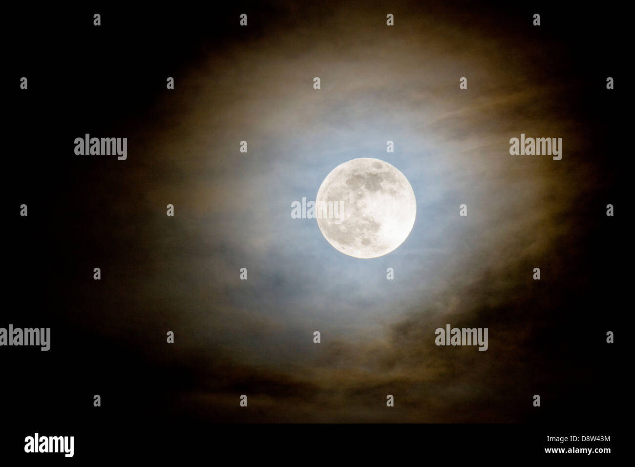 Full moon rising over Rocky Mountains, Salida, Colorado, USA - Stock Image