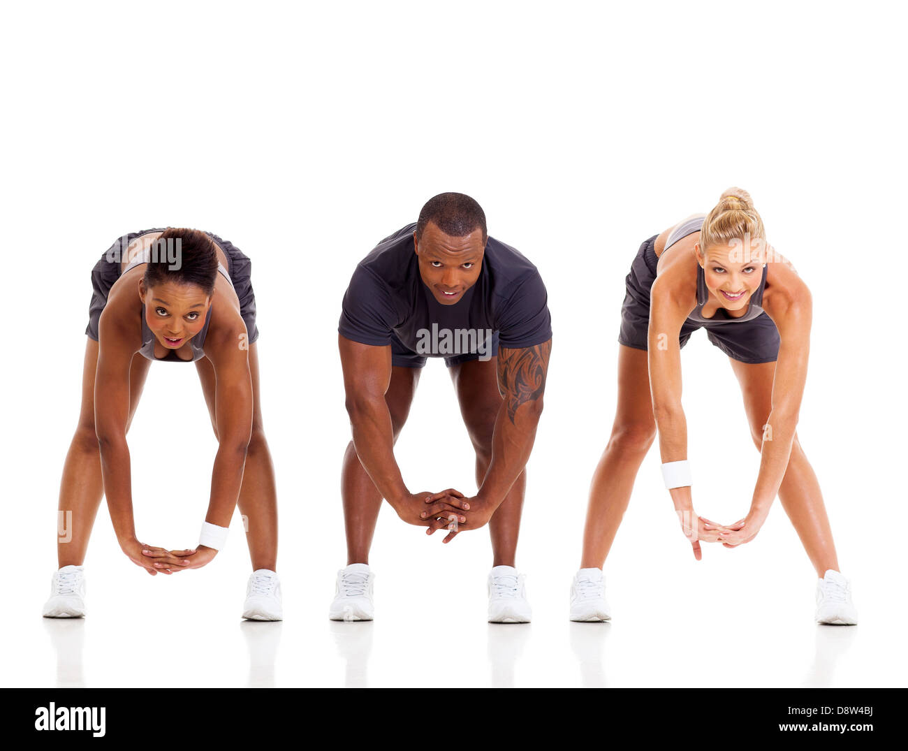group of three people stretching isolated on white - Stock Image