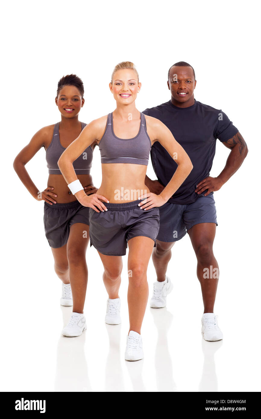 group of cheerful people exercising on white background - Stock Image