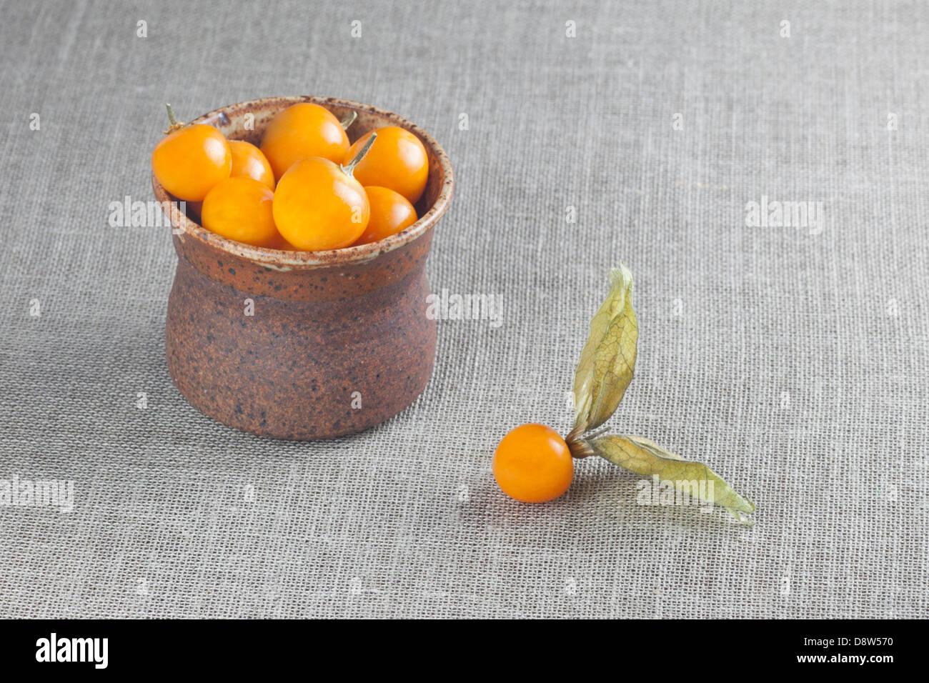 Fresh golden berries (Physalis peruviana) on Irish linen - Stock Image