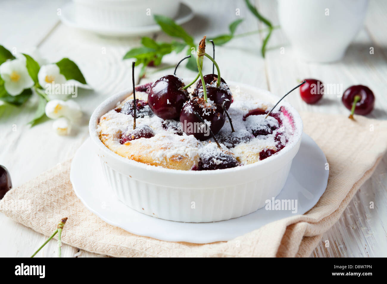 Cherry Clafoutis with powdered sugar, food close up - Stock Image