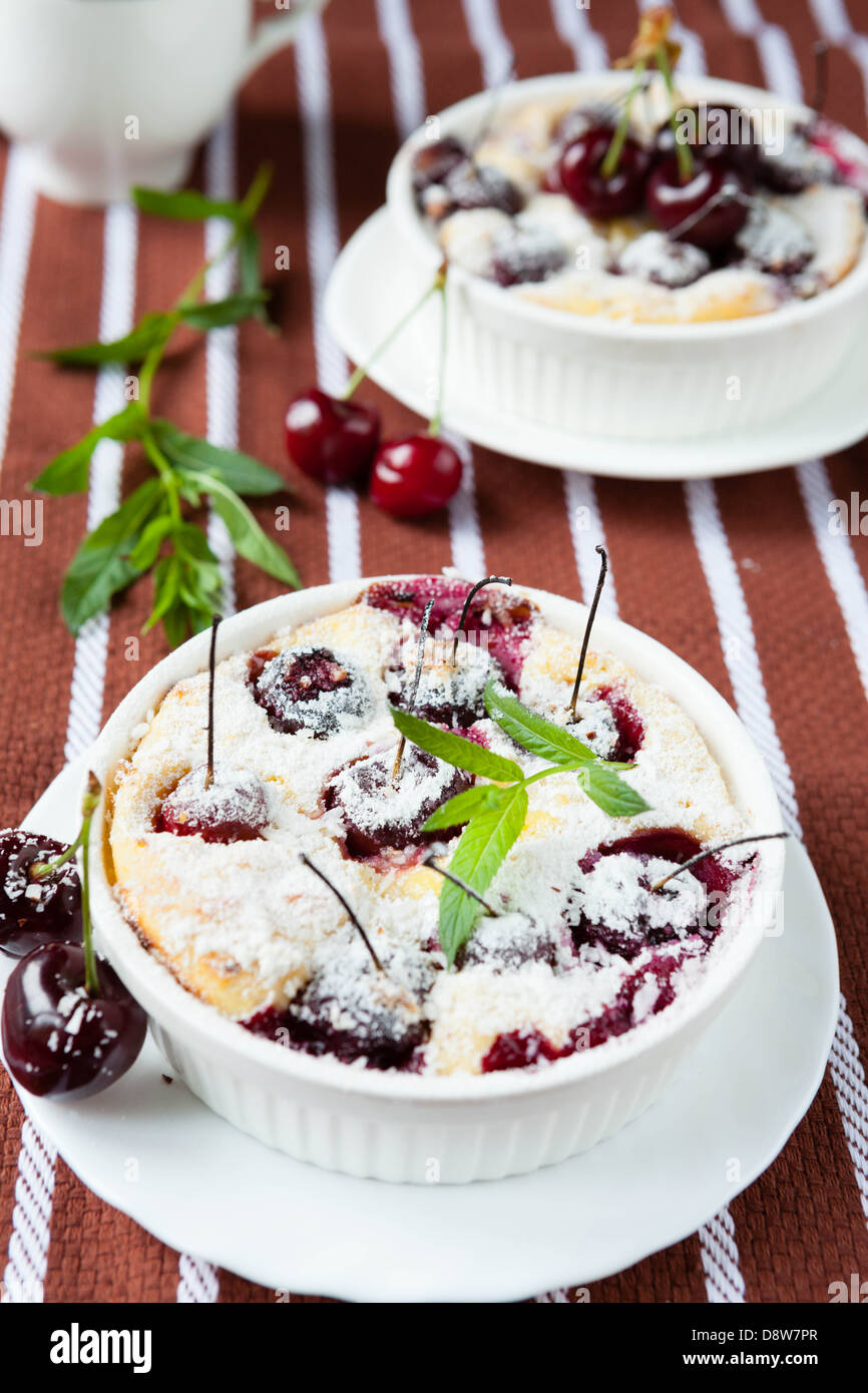 cherry pudding in a baking dish, close up - Stock Image