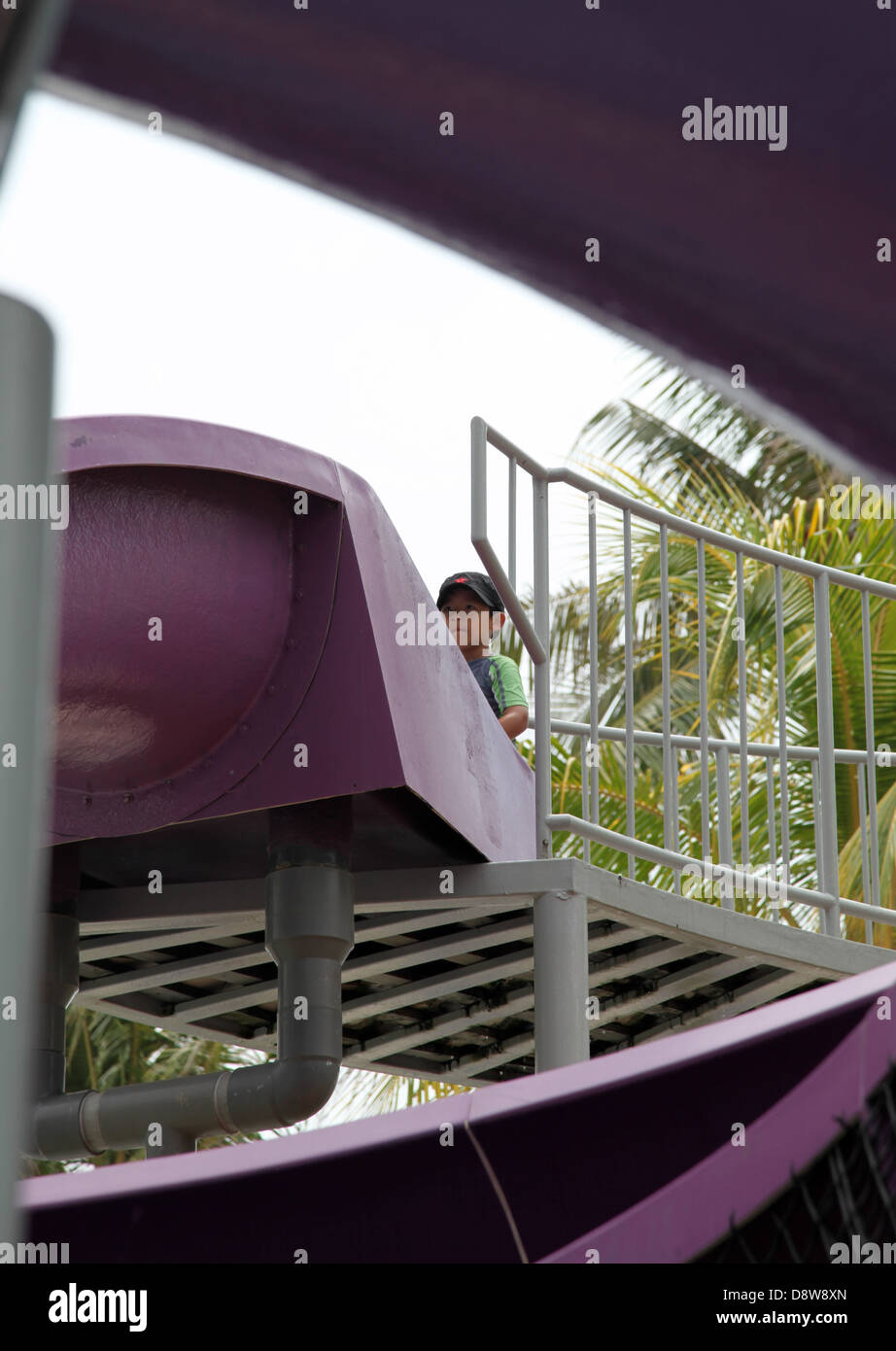 2782025e1 It s a photo of a purple plastic giant slide in a hotel resort. We ...