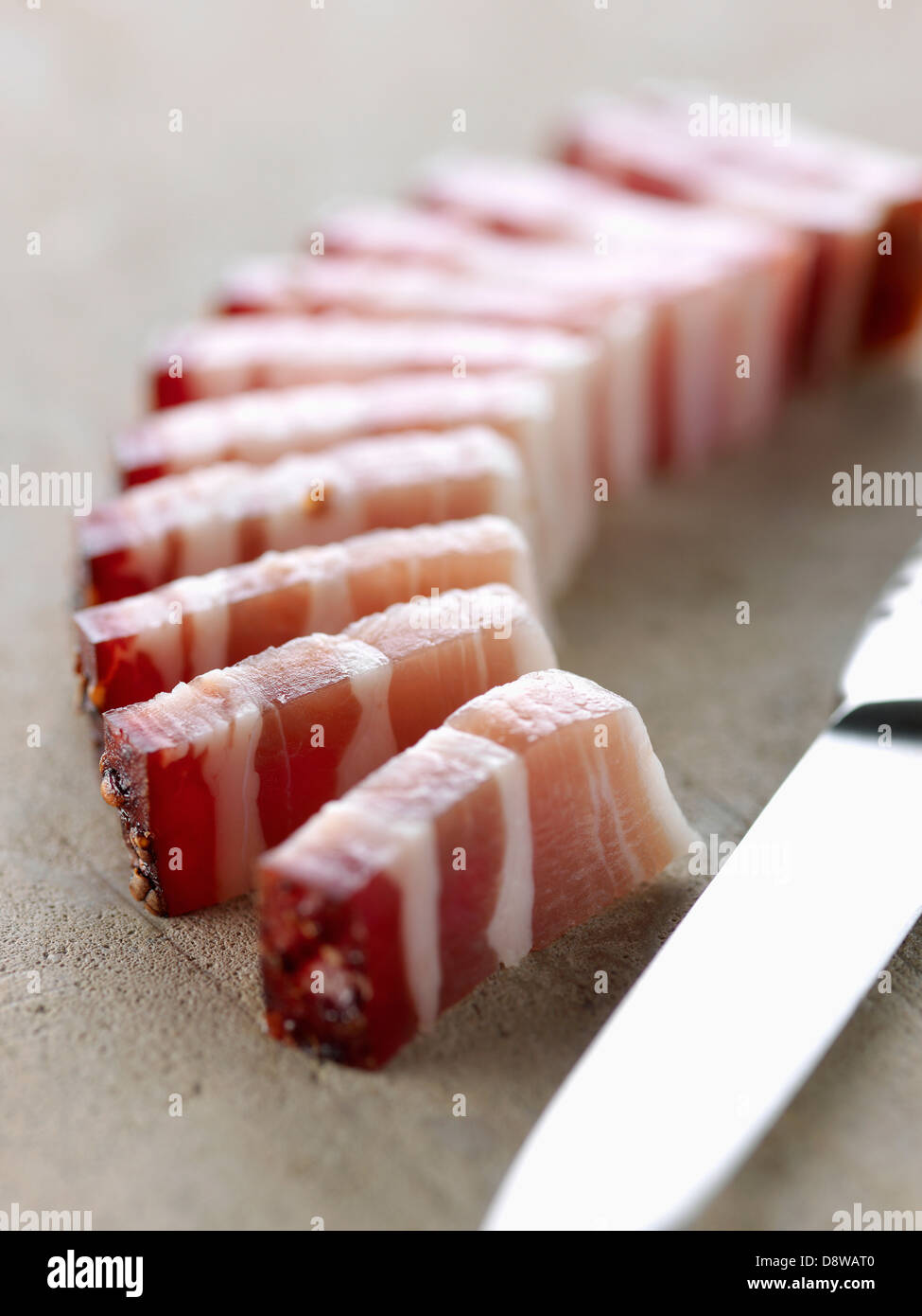 Dicing streaky bacon - Stock Image