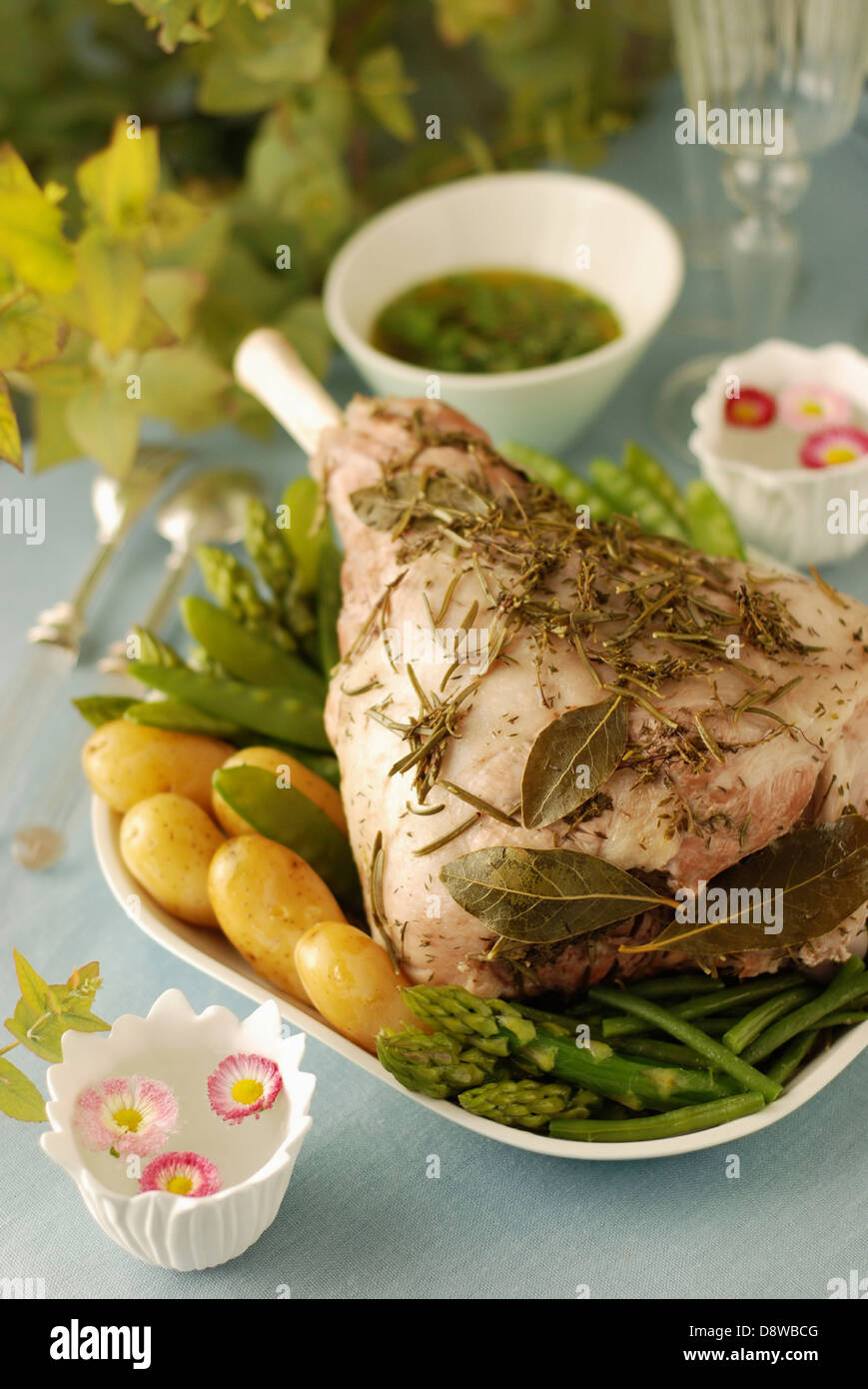 Shoulder of lamb cooked with herbs in a cloth - Stock Image