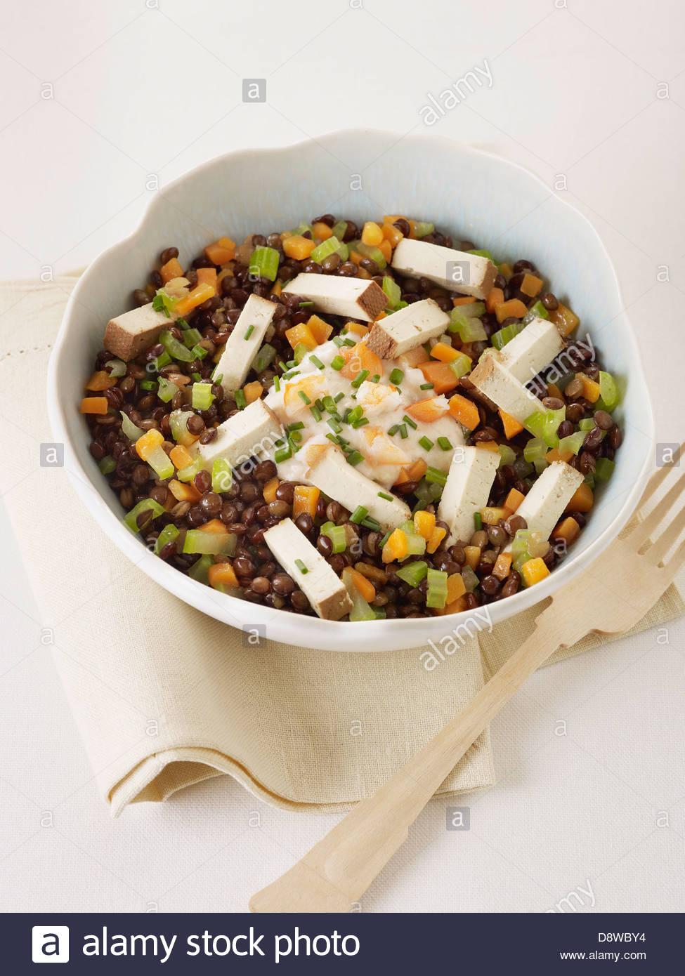 Lentil and smoked tofu salad - Stock Image