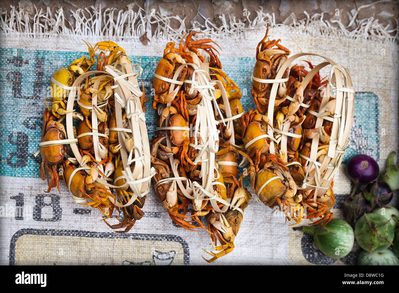 Fresh water crabs on a stall at the market in Luang Prabang, Laos - Stock Image