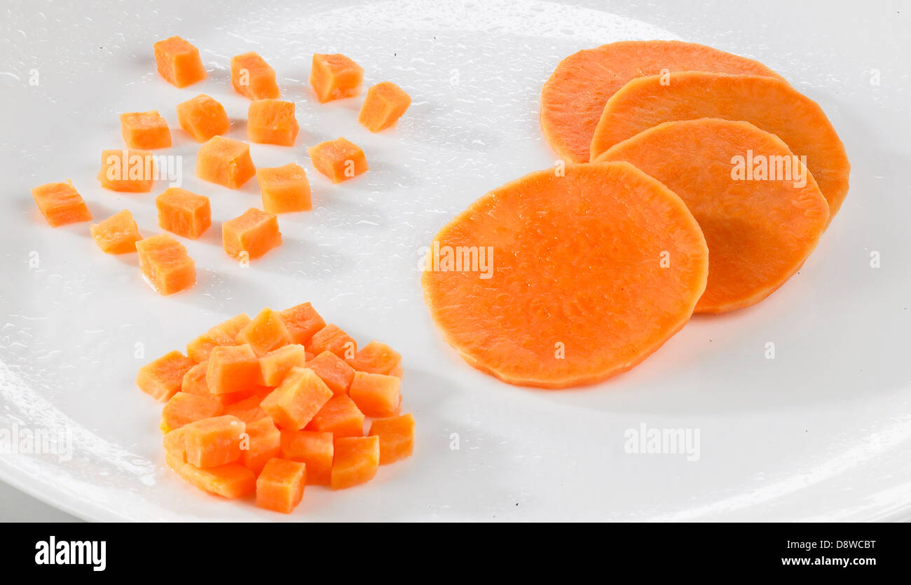 Different ways of slicing sweet potaoes - Stock Image