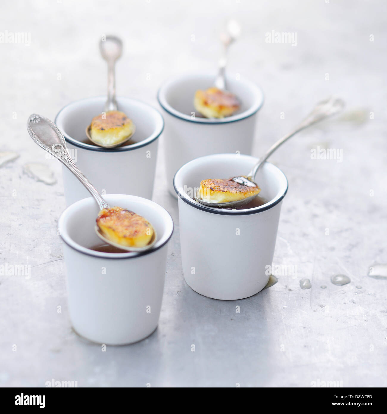 Spoonfuls of Creme brulée - Stock Image