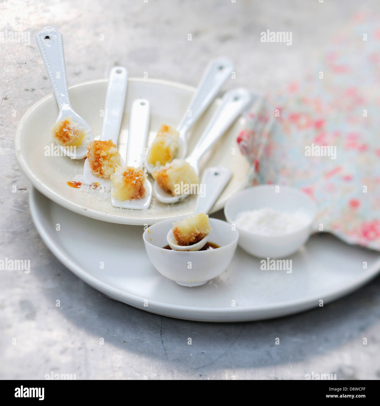 Spoonfuls of coconut fondant with caramel - Stock Image