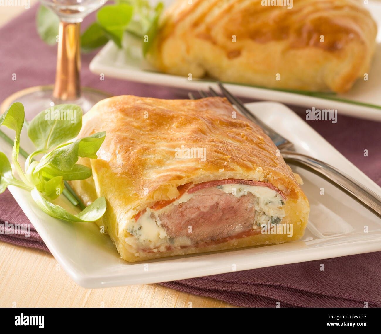 Meat and cheese flaky pastry pie - Stock Image