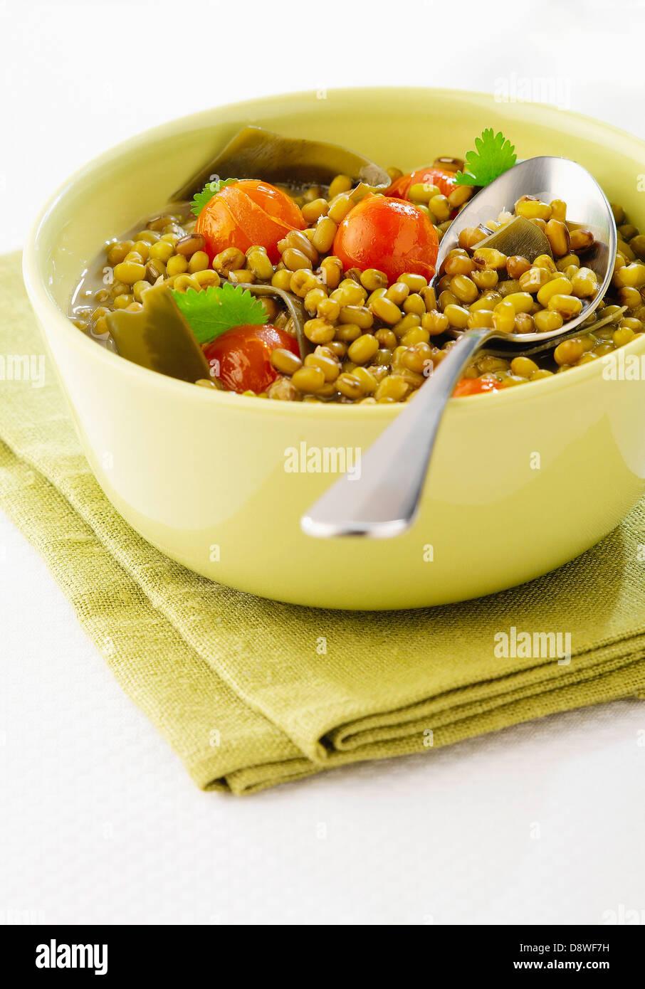 Soya bean and tomato salad - Stock Image