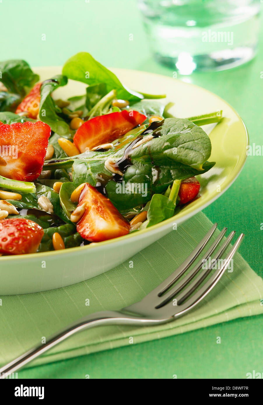 Spinach,strawberry and pine nut salad - Stock Image