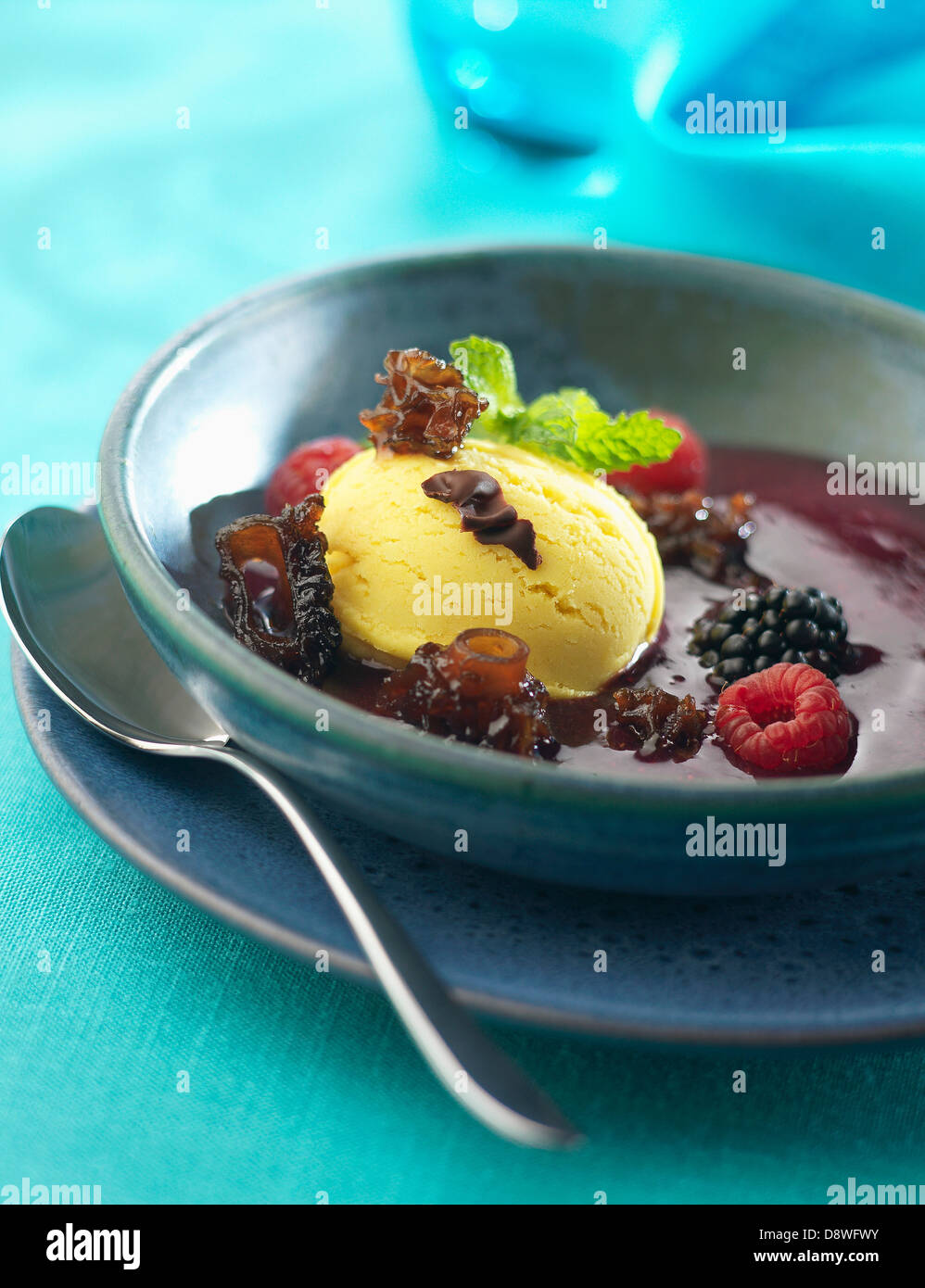 Chocolate soup with fruit and mushrooms and a scoop of ice cream - Stock Image