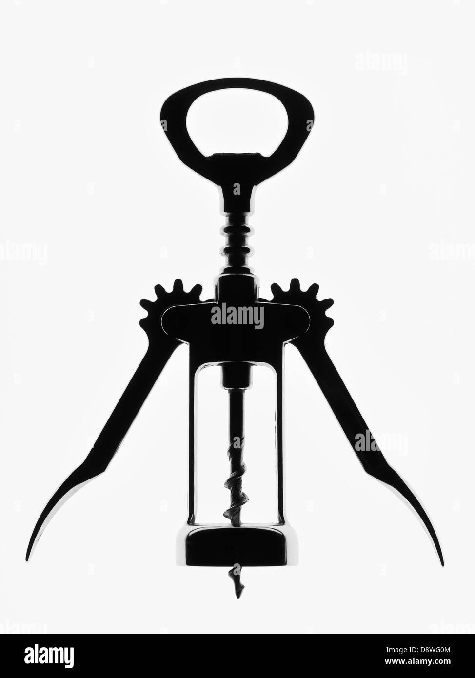 Close up of black corkscrew on white background, studio shot - Stock Image
