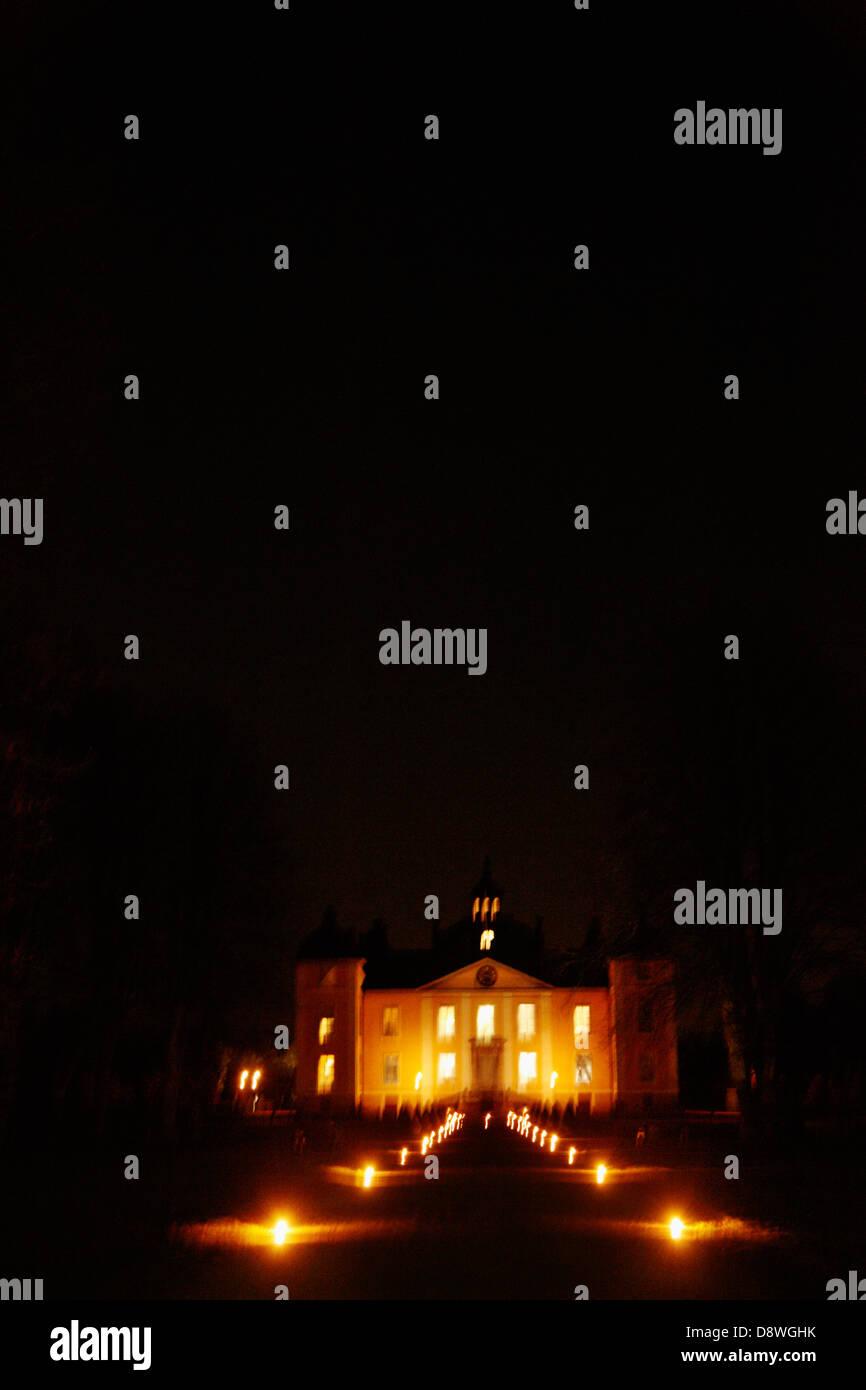 Facade of palace illuminate at night - Stock Image