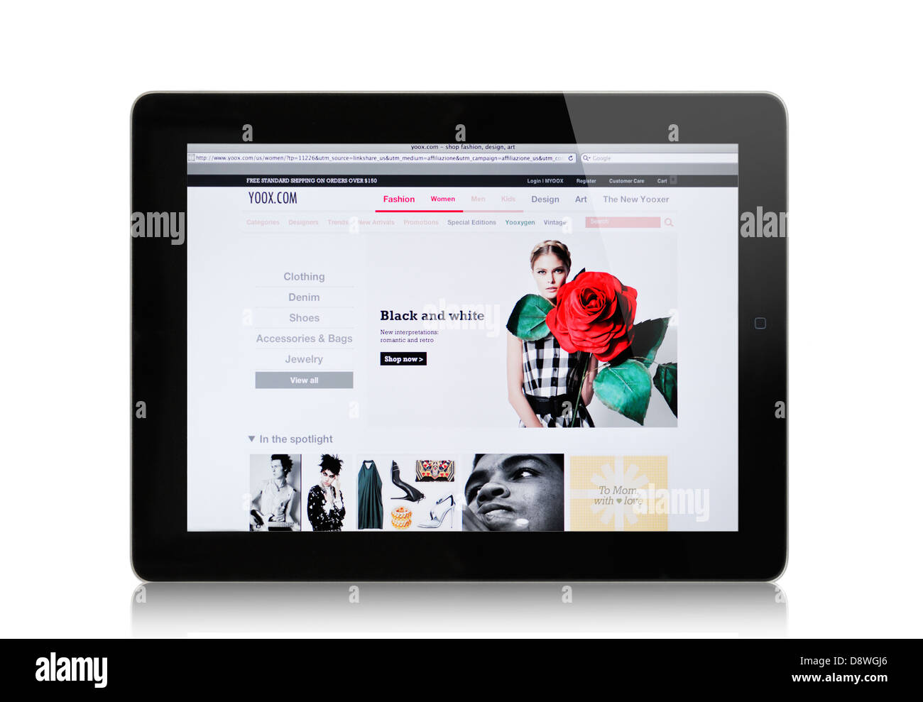 YOOX website on iPad -  Italian internet mail order retailer of men's and women's multibrand clothing and accessories Stock Photo