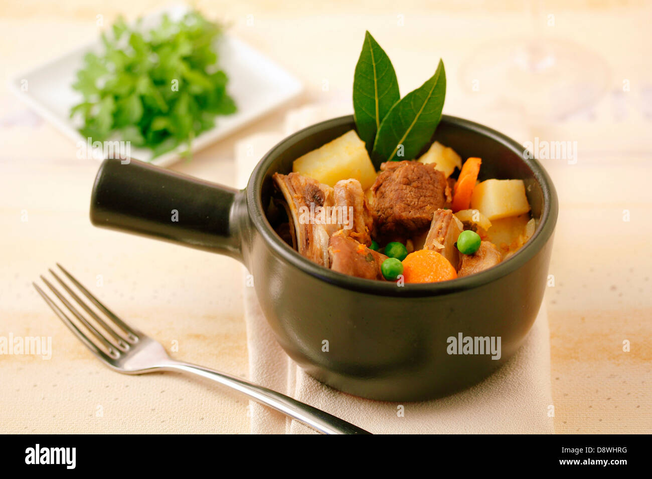Stewed lamb with vegetables. Recipe available. Stock Photo