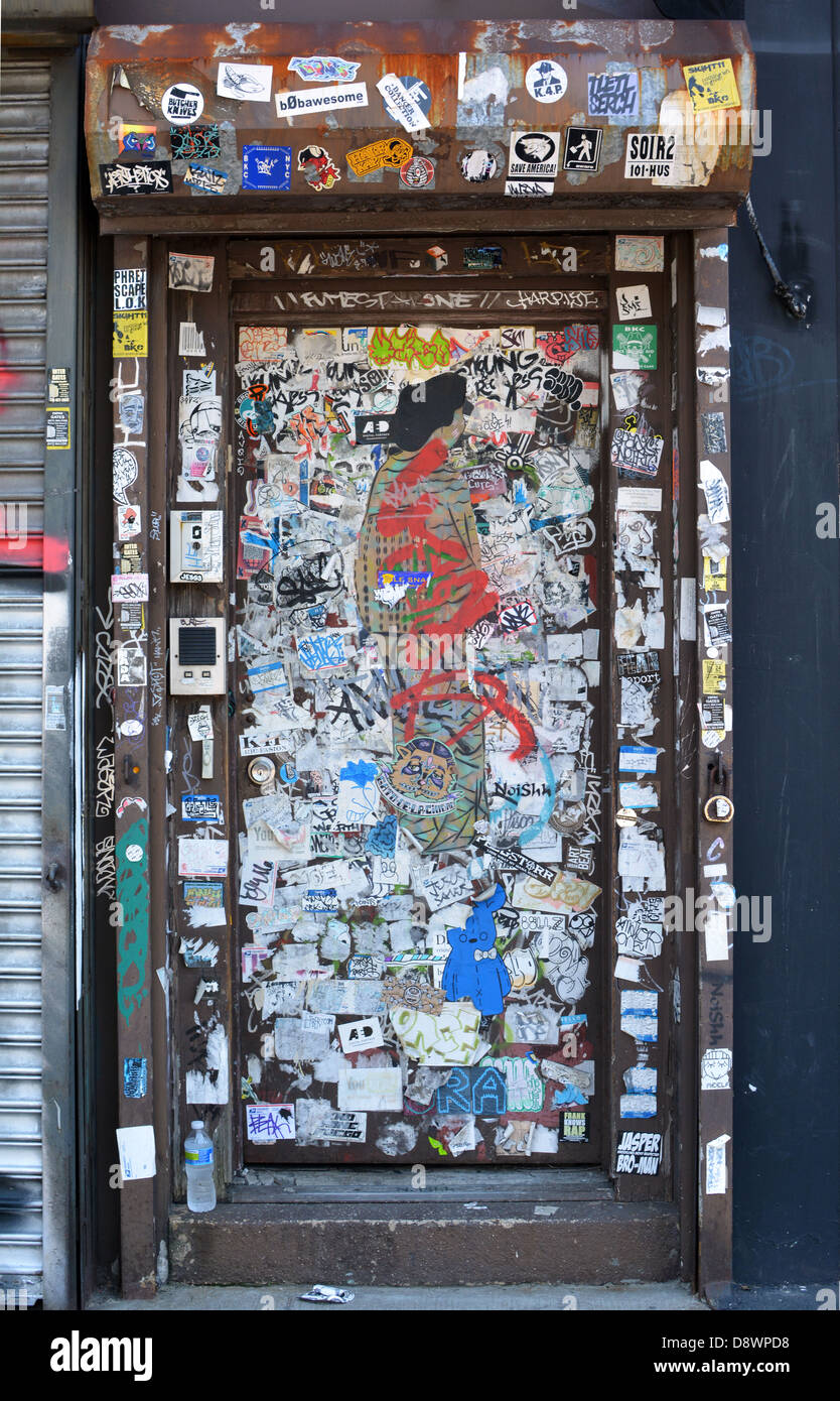 Collage of stickers on a doorway on Jackson avenue in Long Island City, Queens, New York. - Stock Image