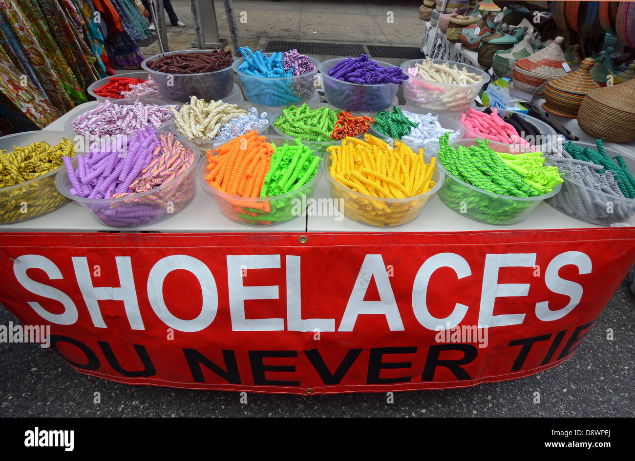 Shoelaces that don't need to be tied on sale at a street fair in Greenwich Village, New York City. Stock Photo