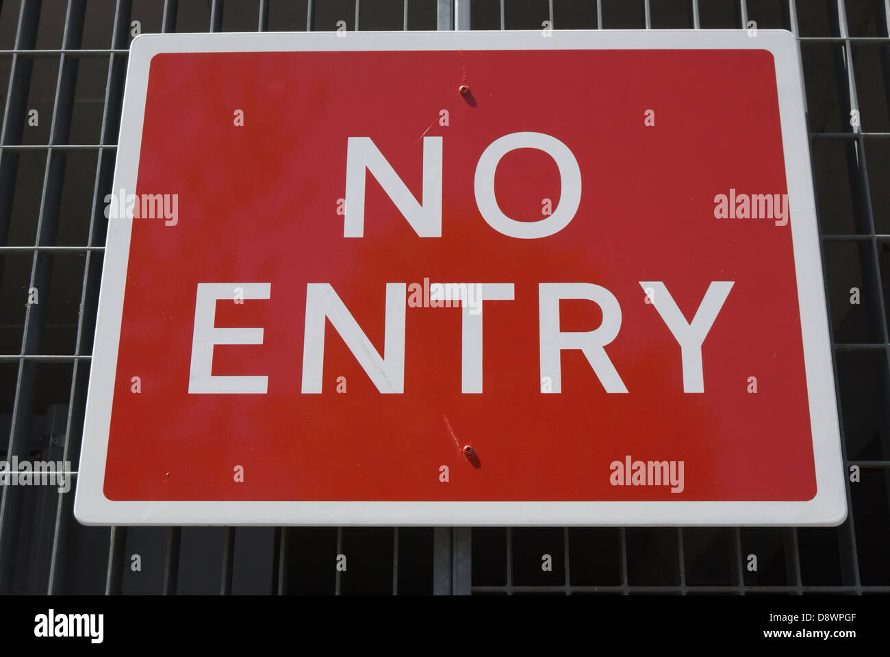 british no entry sign, fixed to a iron grille fence - Stock Image