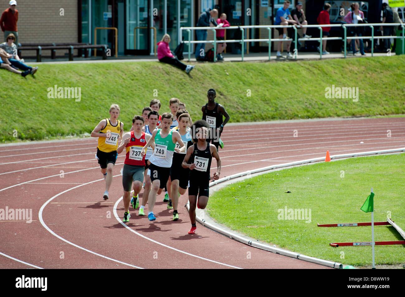 Athletics, teenage boys middle-distance race. - Stock Image