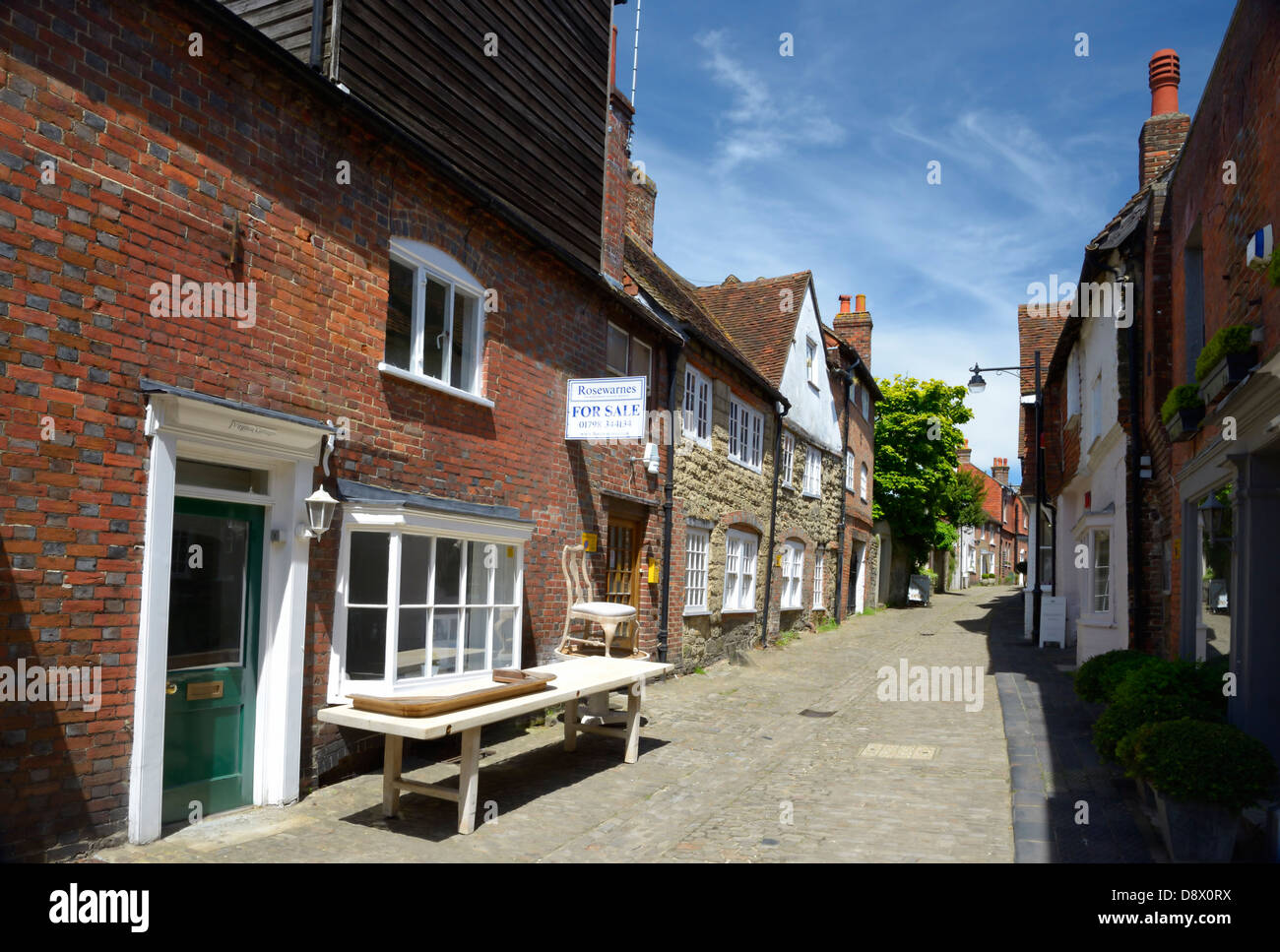 Lombard Street, a cobbled thoroughfare in the market town of Petworth, West Sussex, UK - Stock Image
