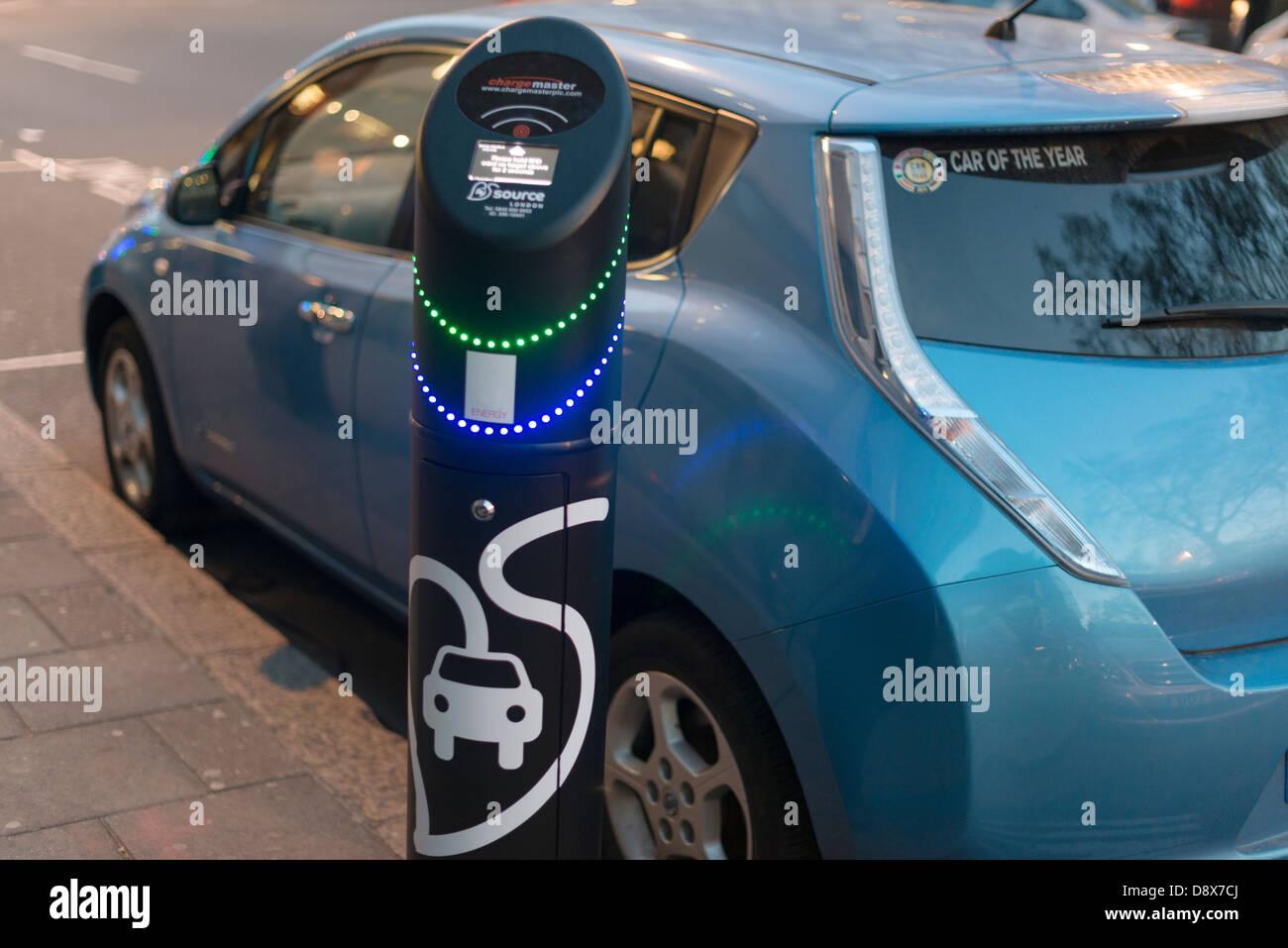 Electric vehicle on charge,London,England - Stock Image