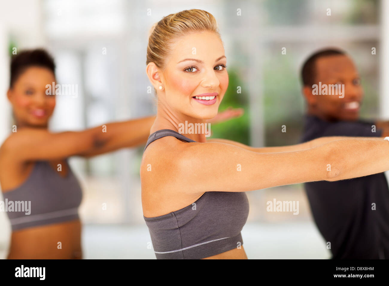 smiling group of fit people working out - Stock Image