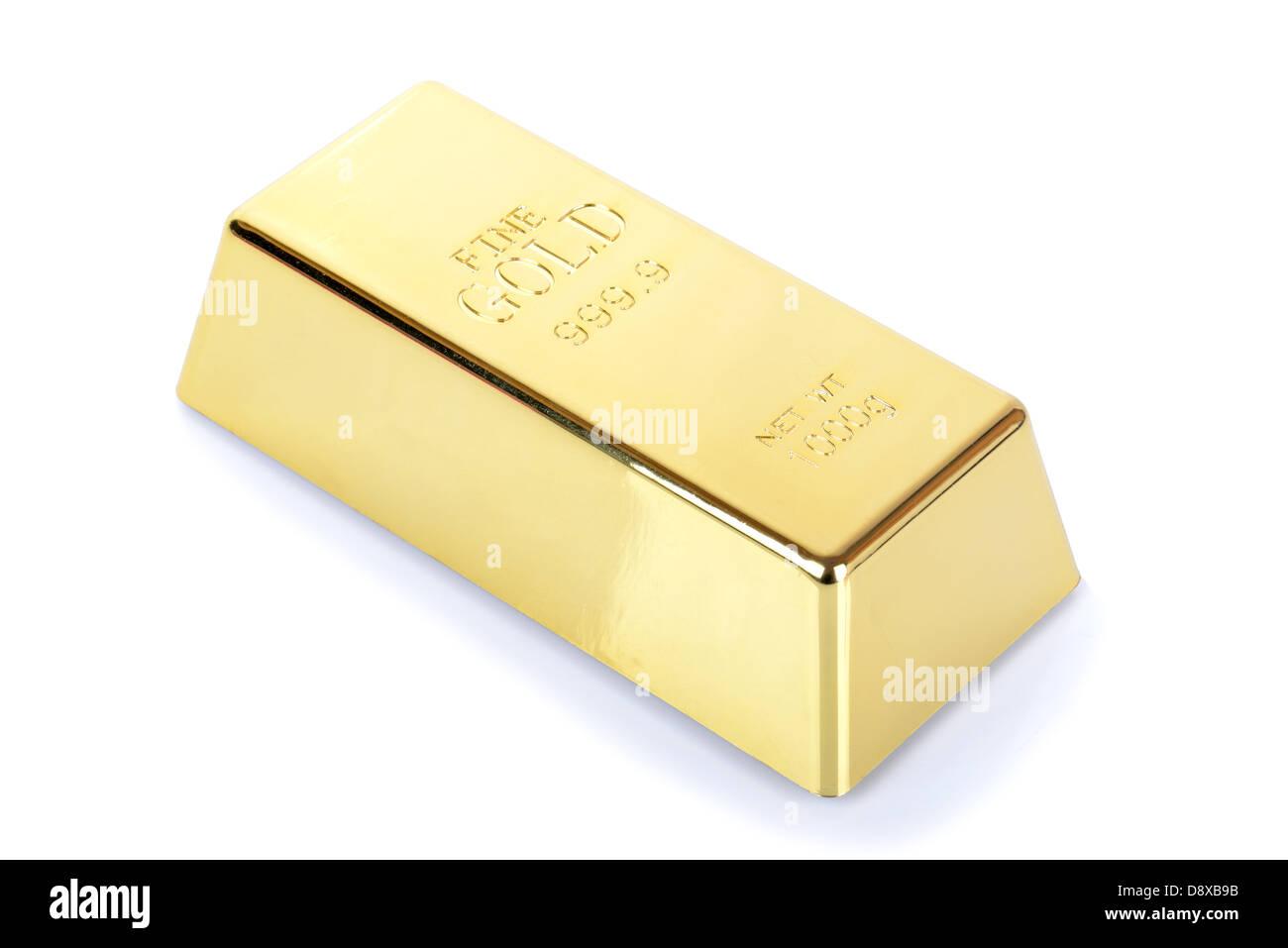 Single gold bullion ingot on white background - Stock Image