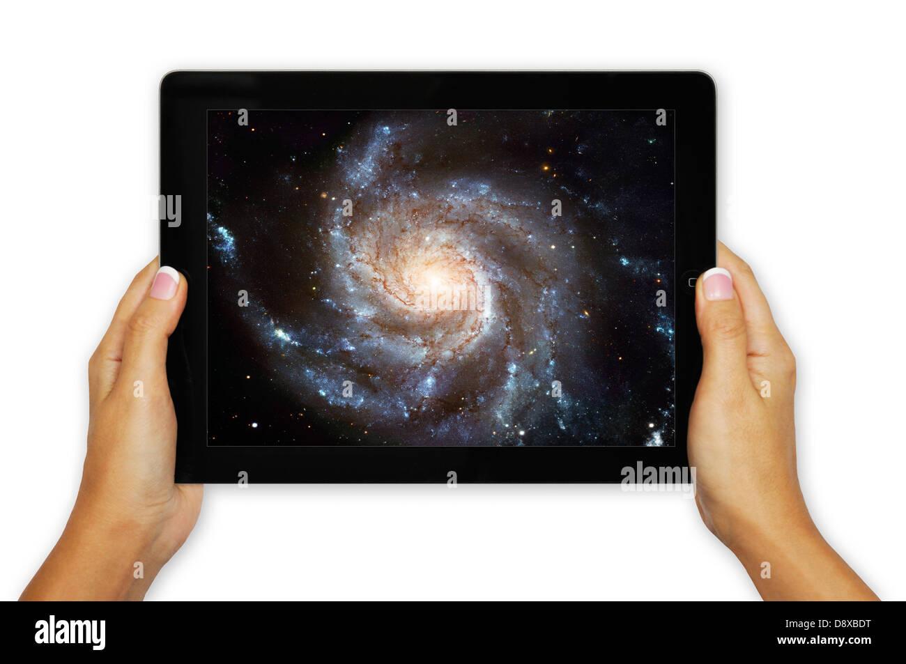 Spiral galaxy M101 ( Pinwheel Galaxy ), Hubble Space Telescope on iPad Stock Photo
