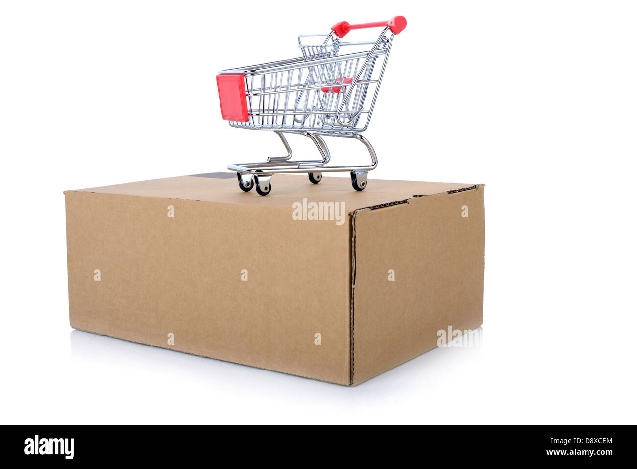 concept of Internet shopping of a push cart isolated on top of a package - Stock Image
