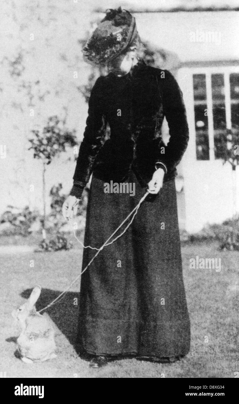 1891 photo of Beatrix Potter, the author of Peter Rabbit books, with her bunny pet - Stock Image