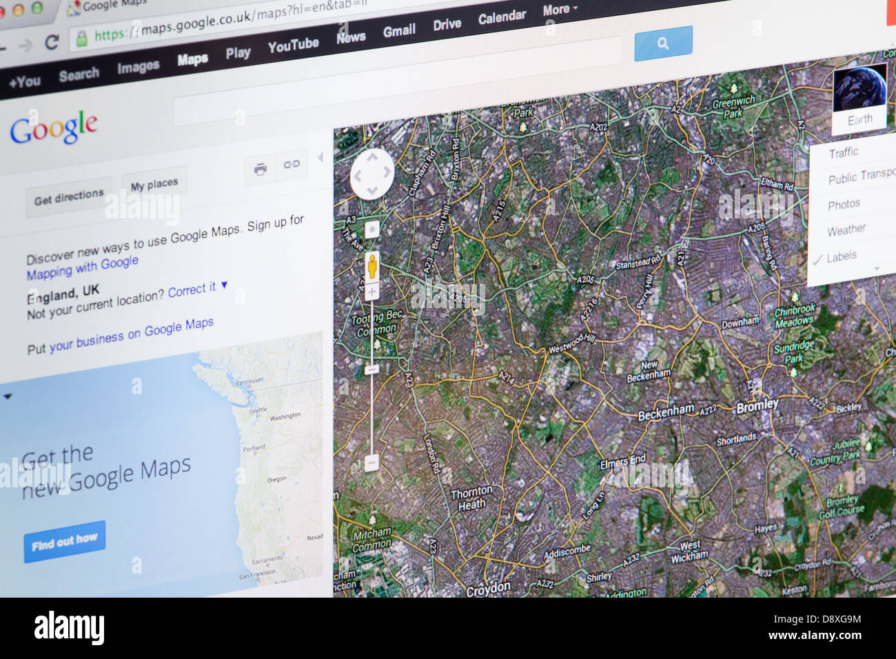 Google Maps Satellite View Mapping Website or web page on a laptop screen or computer monitor - Stock Image