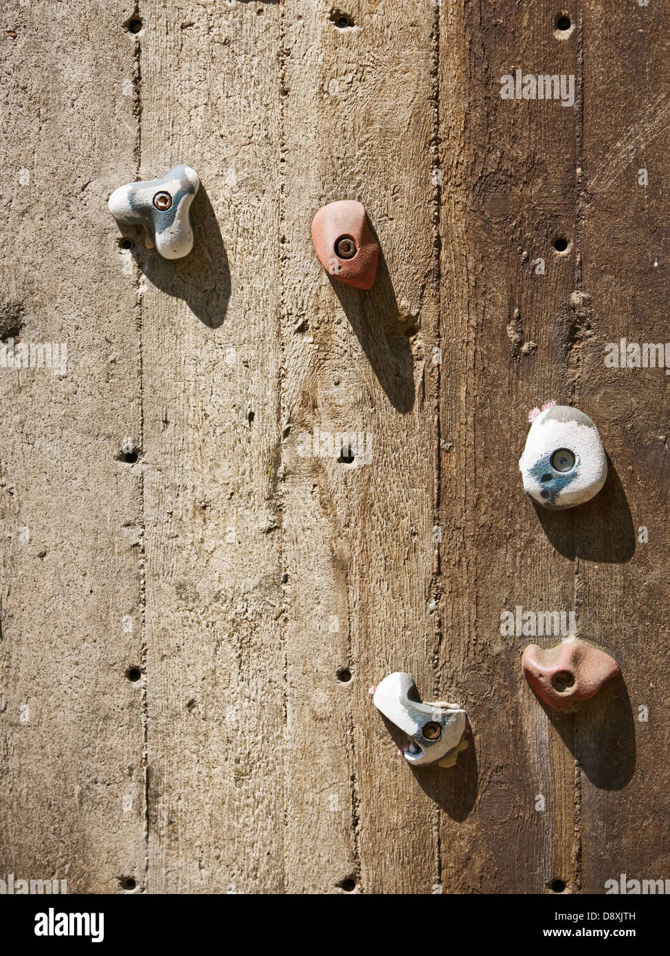 Closeup of wooden climbing wall with five holds - Stock Image