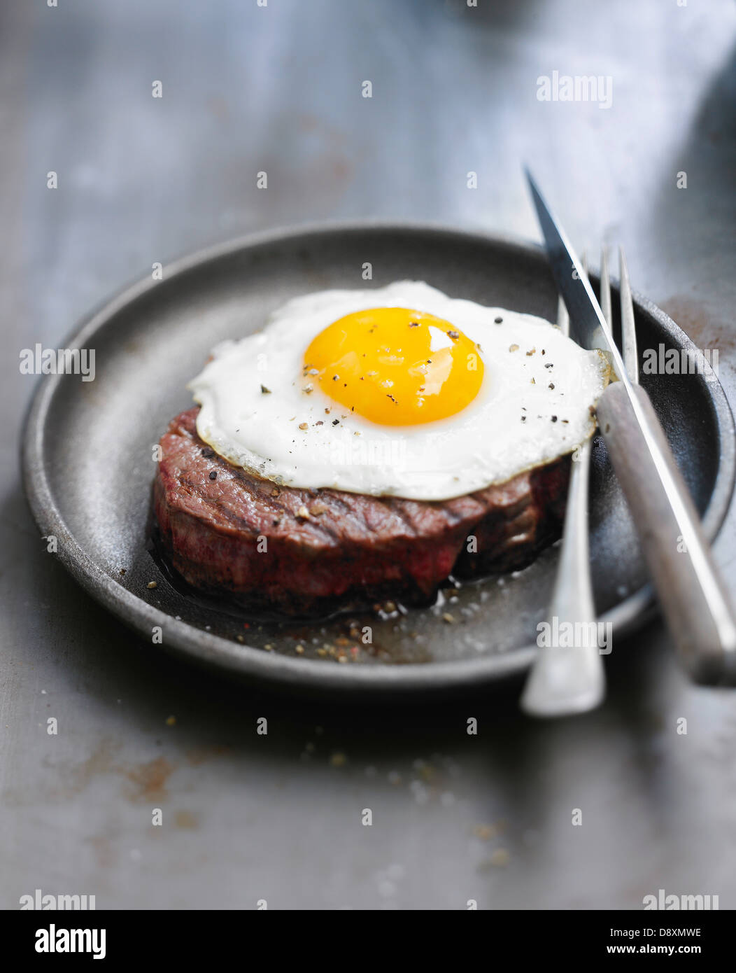 Beef fillet topped with a fried egg - Stock Image