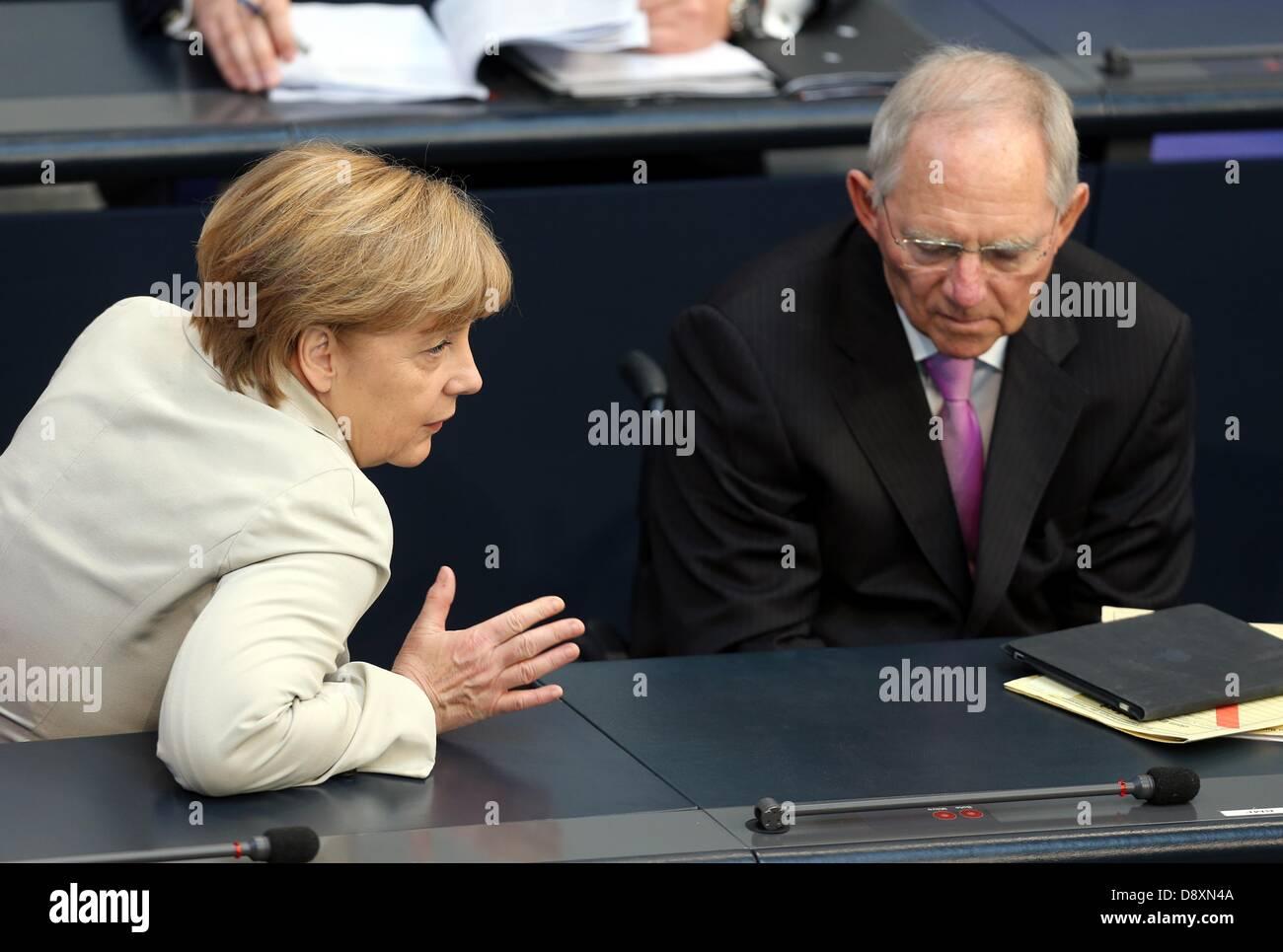 Berlin, Germany. 6th June 2013. Chancellor Angela Merkel talks to German Finance Minister Wolfgang Schäuble - Stock Image