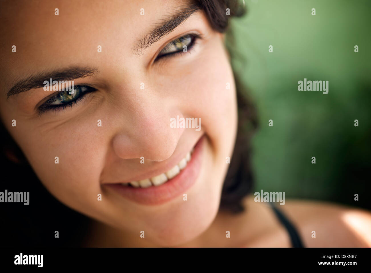 Pretty girl with green eyes, portrait of happy young hispanic woman looking at camera and smiling. Sequence - Stock Image