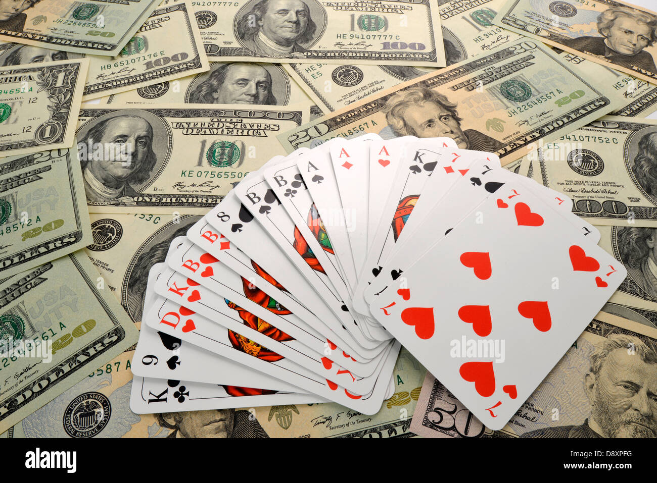 Symbolic picture game of chance, dollar notes, playing cards - Stock Image