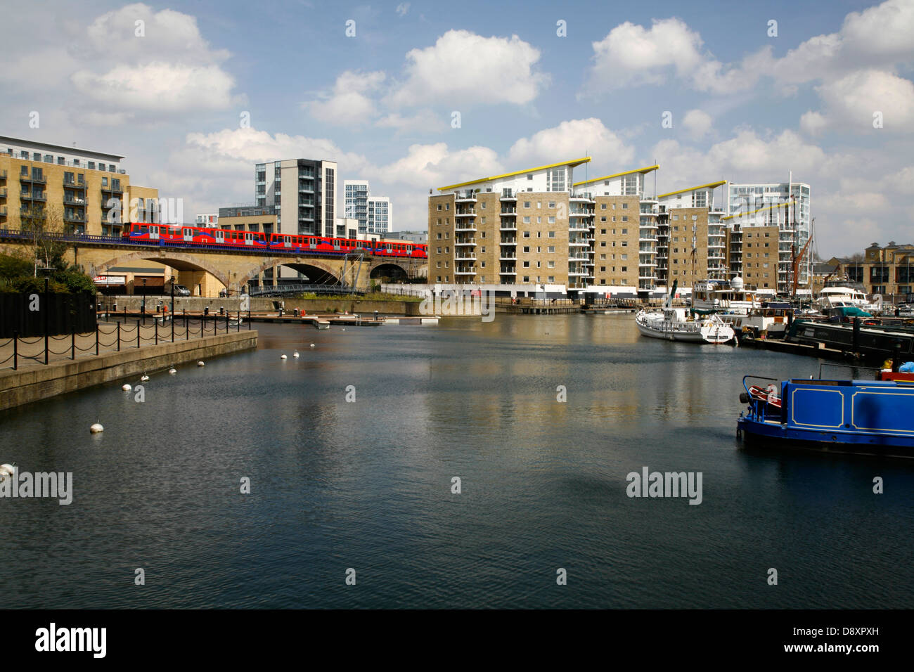 DLR train crossing the back of Limehouse Basin, Limehouse, London, UK - Stock Image