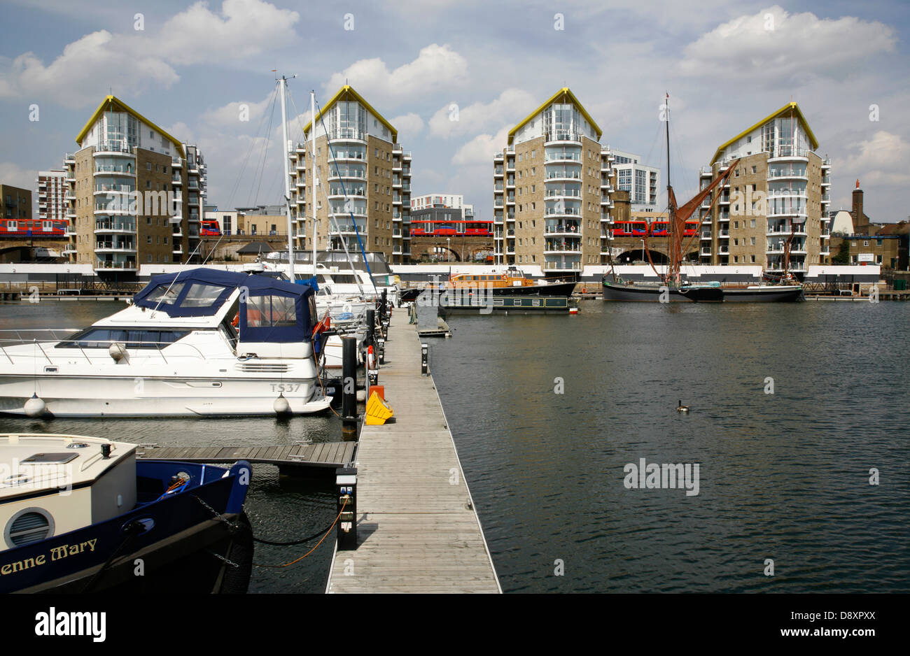 DLR trains crossing the back of Limehouse Basin, Limehouse, London, UK - Stock Image