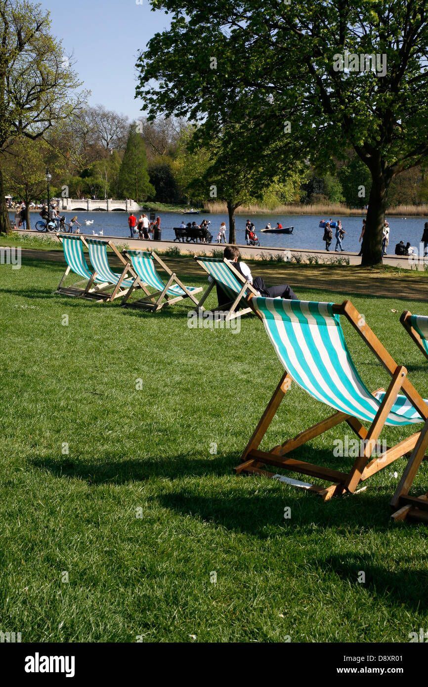 Deckchairs in front of the Serpentine, Hyde Park, London, UK - Stock Image