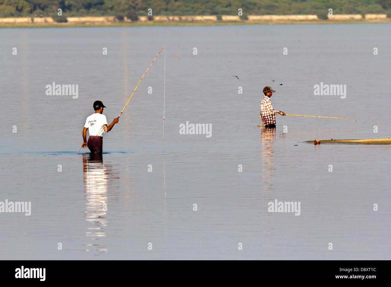 Fishermen trying their luck in Taungthaman Lake, Myanmar - Stock Image