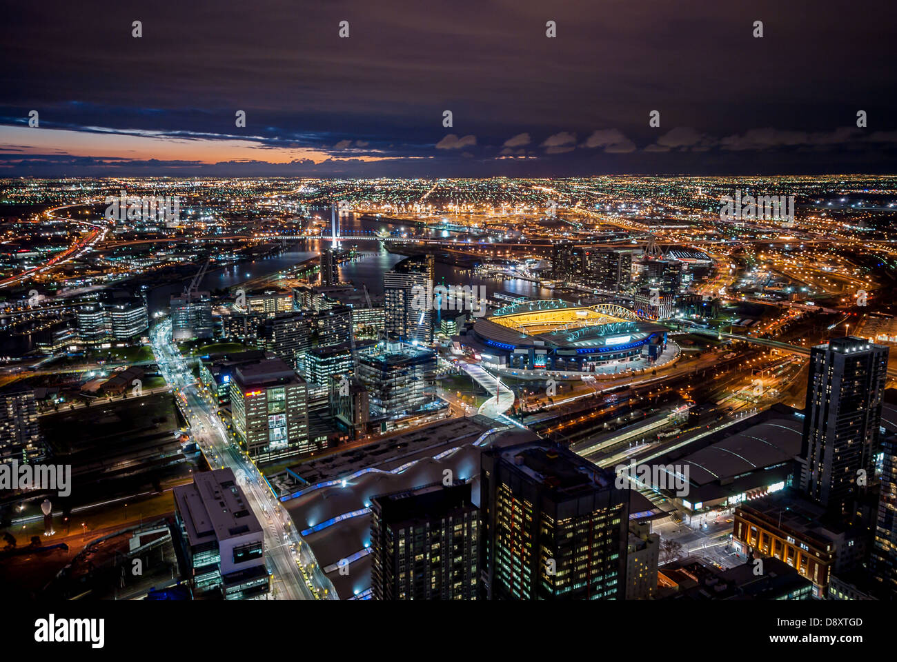The lights of the city come on after sundown in Melbourne, Australia. - Stock Image