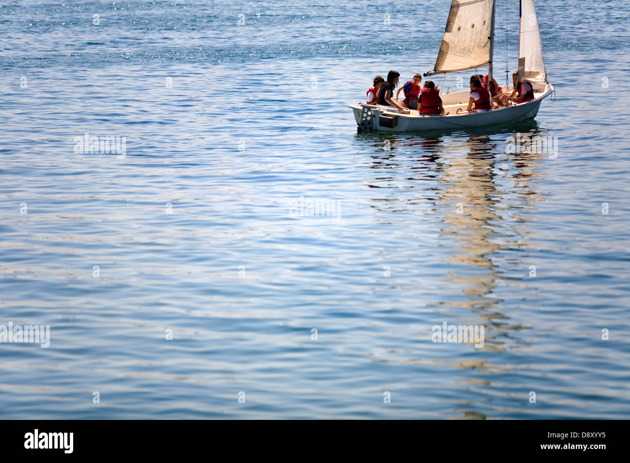 sailing boat instructor and pupils sailing. Santoña. Cantabria. Spain. Europe. - Stock Image