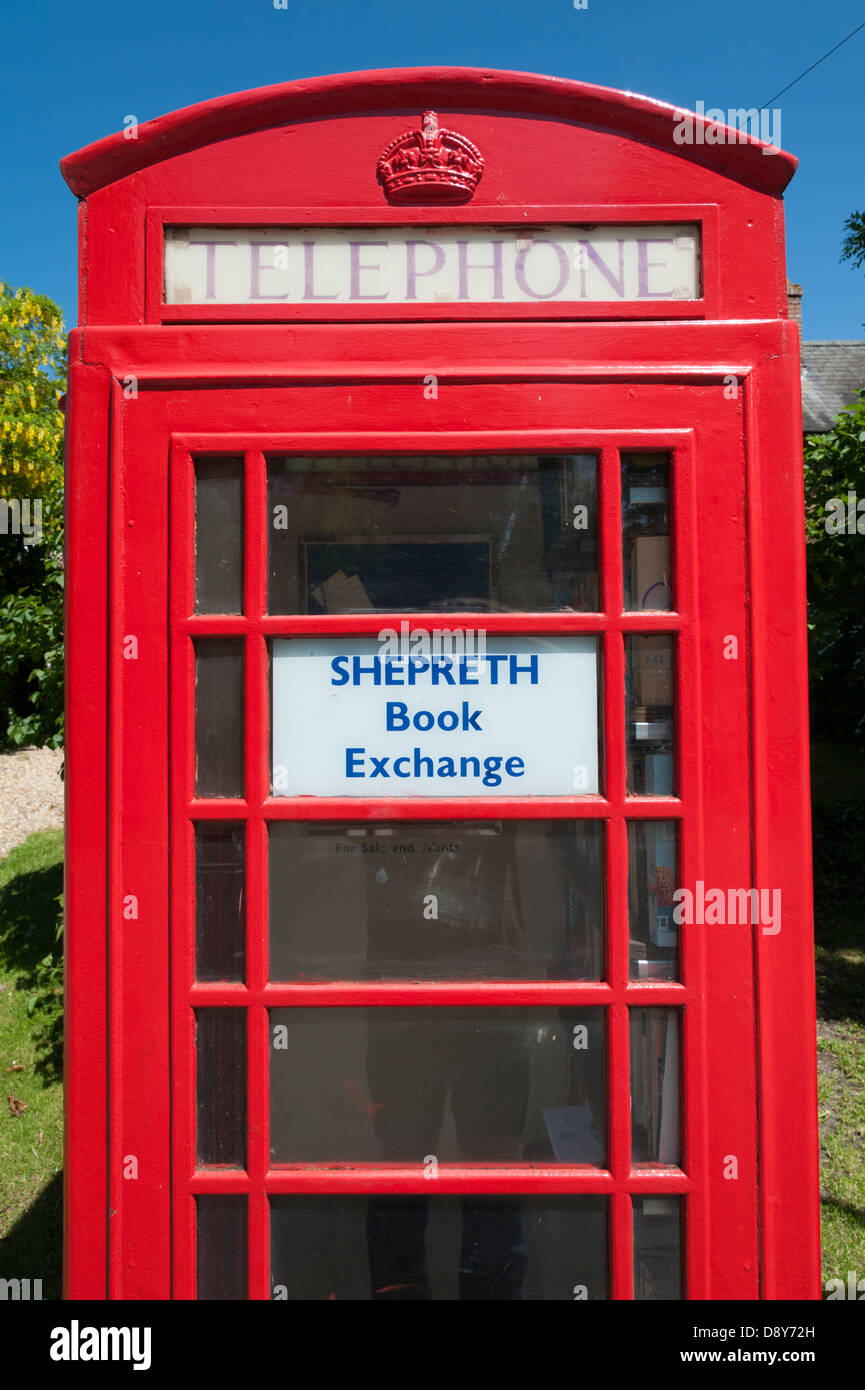 The book exchange in the village of Shepreth South Cambridgeshire village. A community book store in an old telephone - Stock Image