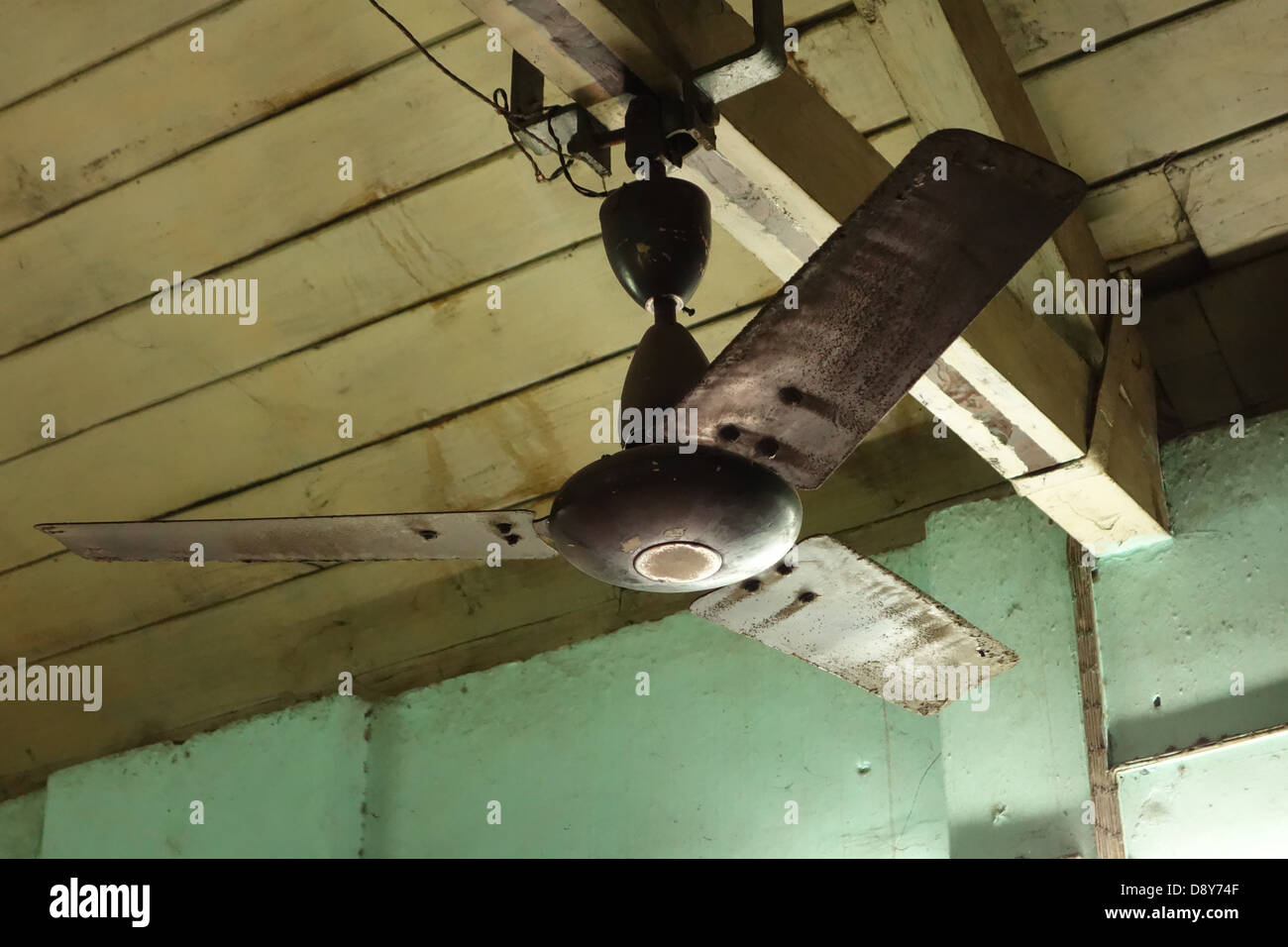 Old Ceiling Fan Mounted On Rafters   Stock Image