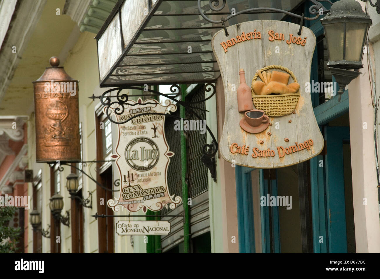 Colonial style buildings in the old Havana with old signs advertizing shops and cafes.  Panaderia San Jose Cafe - Stock Image