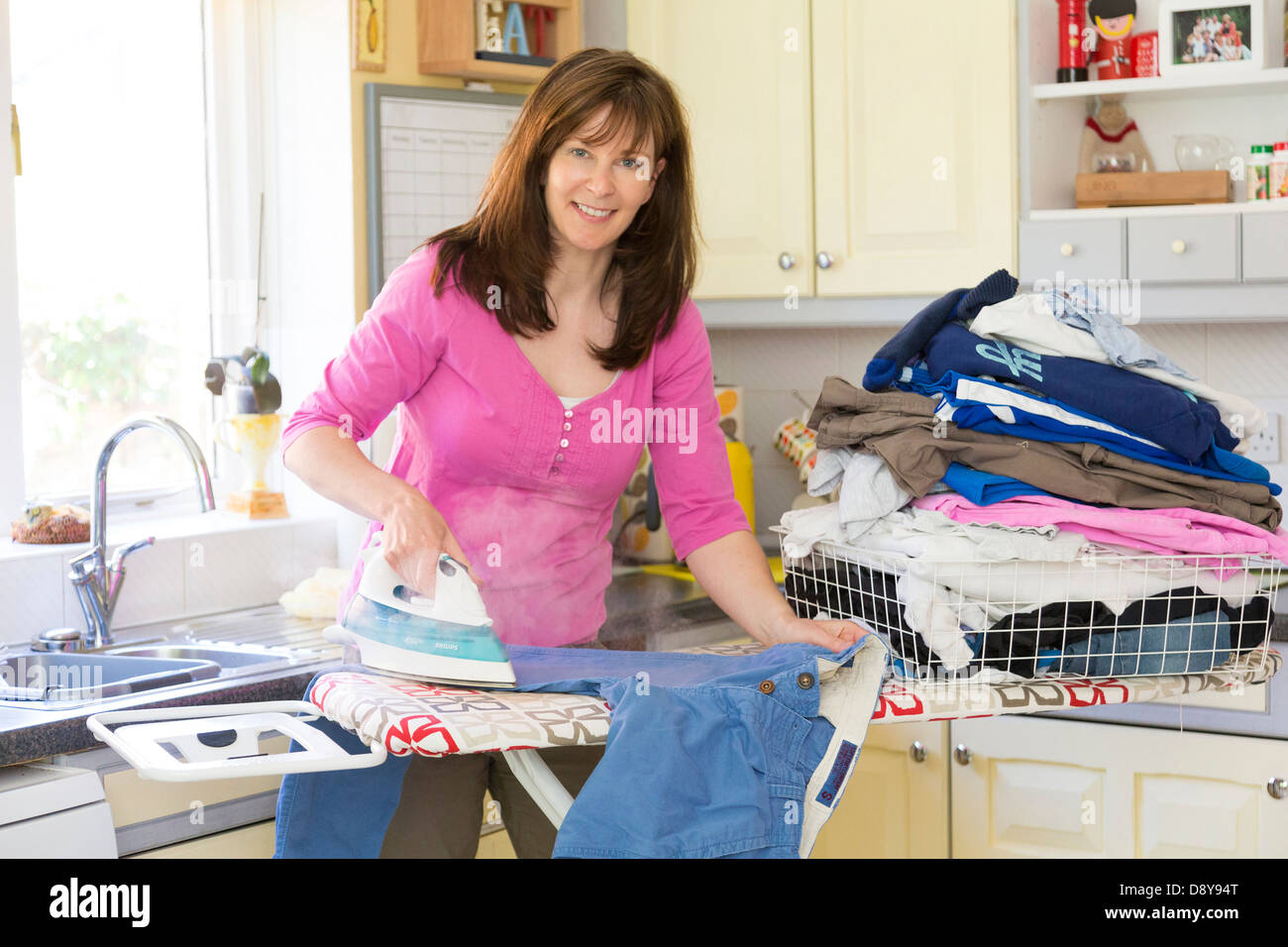woman doing the ironing - Stock Image